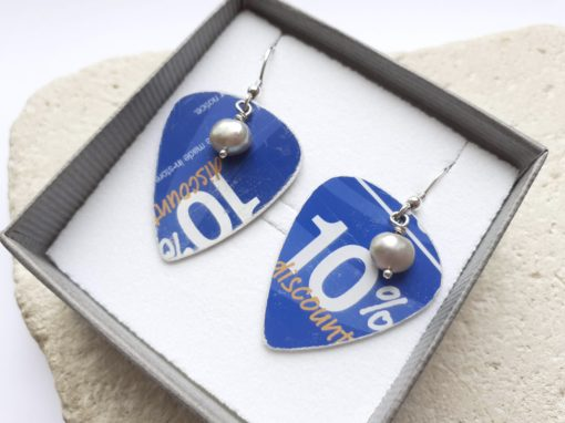 Blue 10% Plectrum earrings close up in gift box