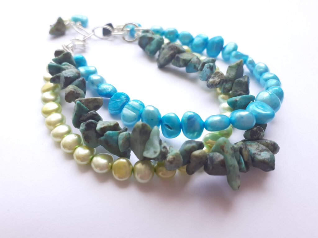 Multi Strand Freshwater Pearl Bracelet with Dangle Stones